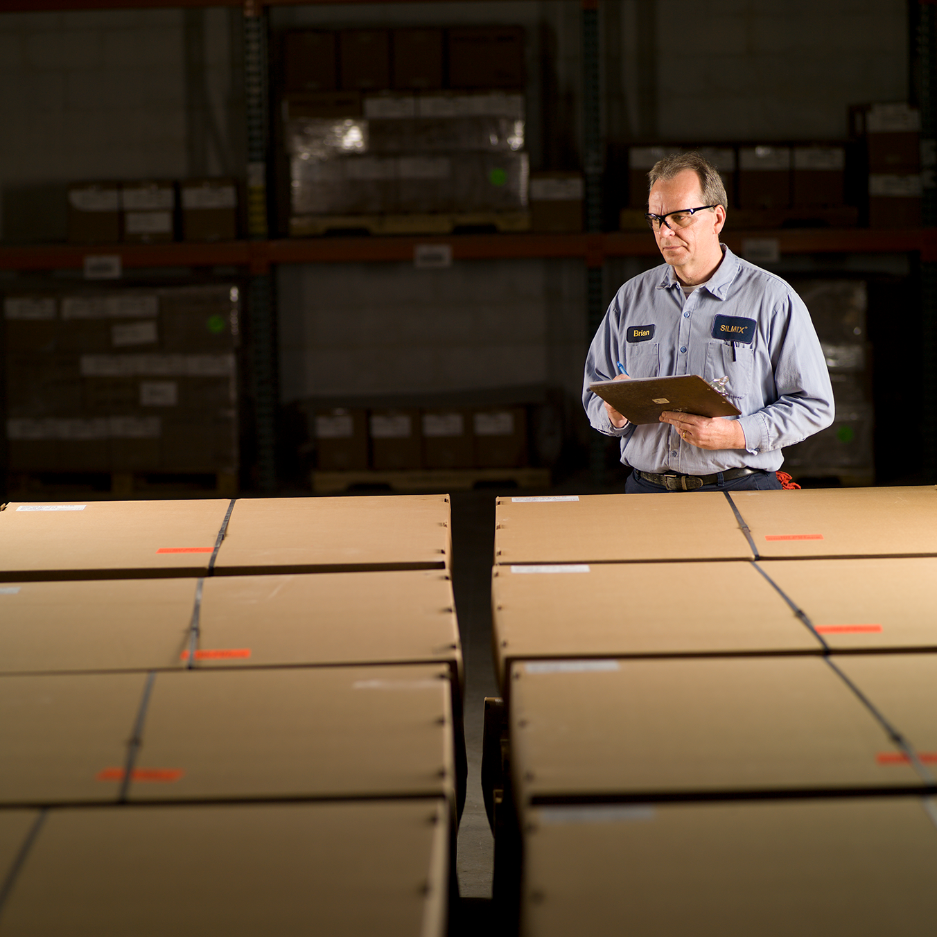 man reviewing delivery boxes